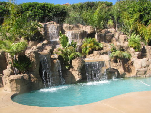 Pool remodel: All of the artificial rock work was added to an existing pool on an upslope.